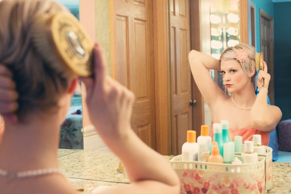 woman makeup in the mirror