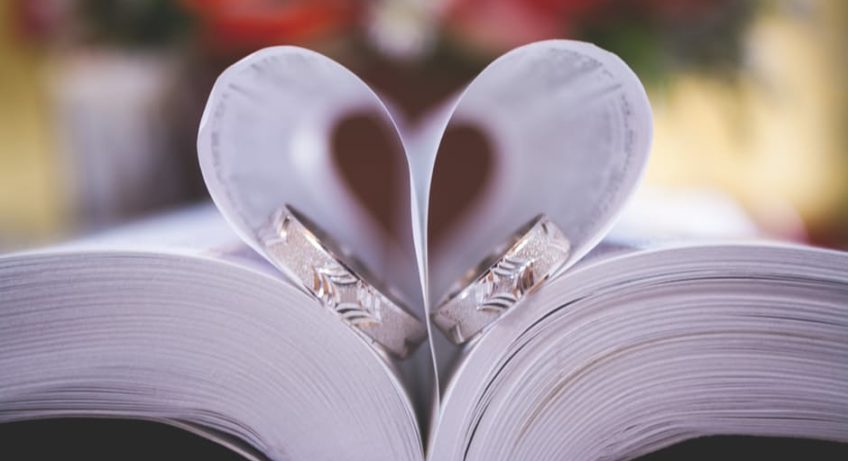 Wedding Planning advice heart paper with rings