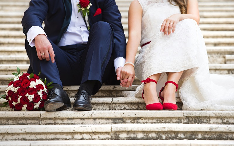 plan your wedding without any stress holding hands on the steps