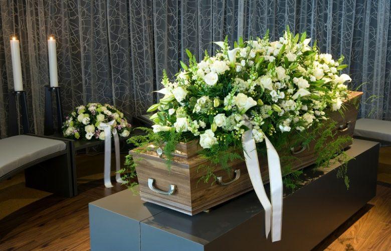 Funeral Flowers on top of casket