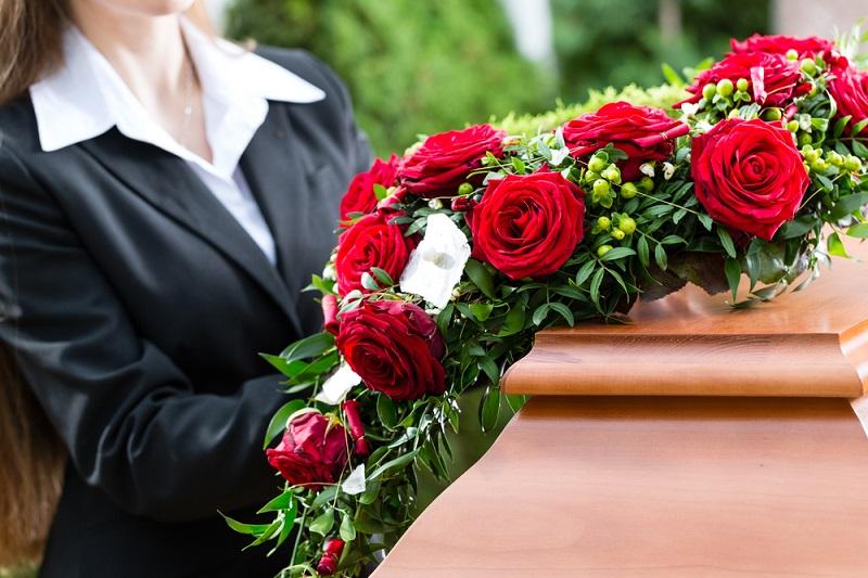Funeral Flowers in hands of pallbearer